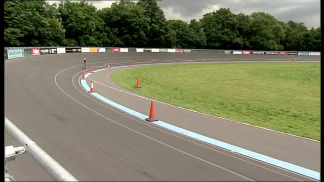 Stage 18 Bradley Wiggins still in yellow jersey ENGLAND London Herne Hill Velodrome Reporter to camera Reporter cycling around track Empty podium...