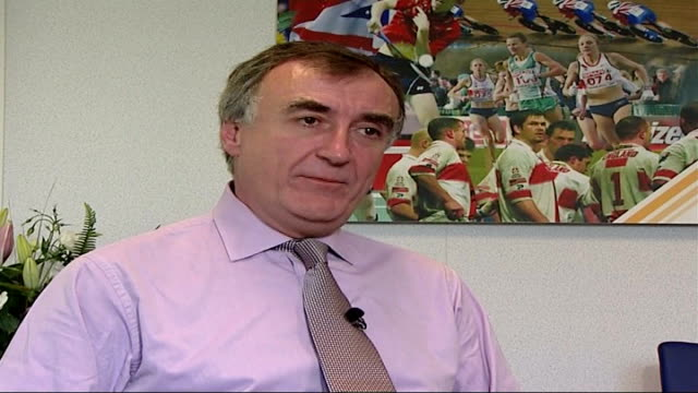 alexander vinokourov fails drug test england int john scott interview sot - john scott stock videos and b-roll footage