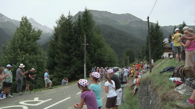 ws tour de france bike race on country road with spectators watching / alps, france - tour de france stock videos & royalty-free footage