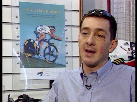 cycling team banned england london chris boardman reading newspaper in sports shop tms newspaper article on tour de france drugs scandal chris... - ツール・ド・フランス点の映像素材/bロール