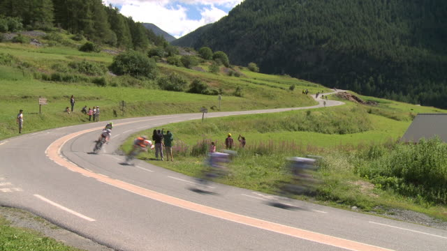 ws tour de france cyclists descend the col d'izoard, briancon - cycling event stock videos & royalty-free footage