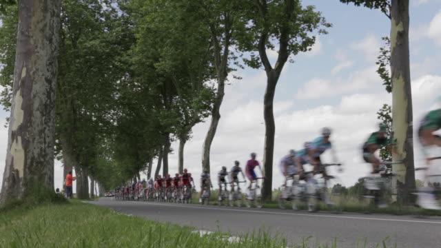 tour de france peloton  on the d904 from villars les dombes - tour de france stock videos & royalty-free footage