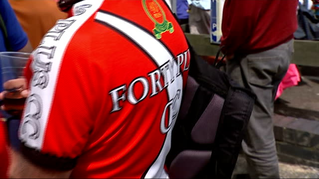 stage three essex reporter to camera car along road beeping horn cycling club members cheering 'forty plus cc' cycle shirts pan chris mills interview... - bicycle seat stock videos & royalty-free footage
