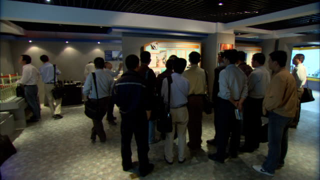 WS PAN Tour guide and visitors at Shanghai Scientific Energy Conservation Exhibition Hall at Shanghai Energy Resource Center, Shanghai, China
