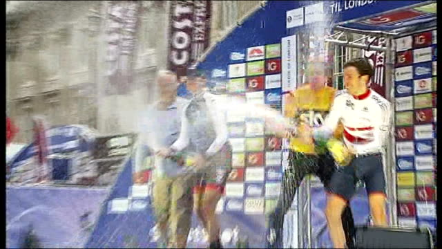 tour of britain wiggins wins england london whitehall ext reporter to camera sot tour of britain winner sir bradley wiggins and others spraying... - tour of britain stock videos & royalty-free footage