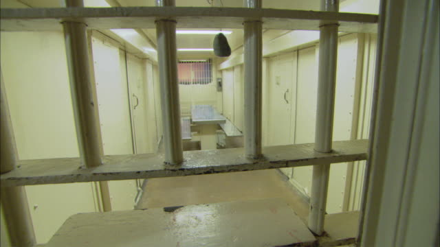 pov tour of inside jail cell area / corpus christi, texas, united states - jail cell stock videos & royalty-free footage