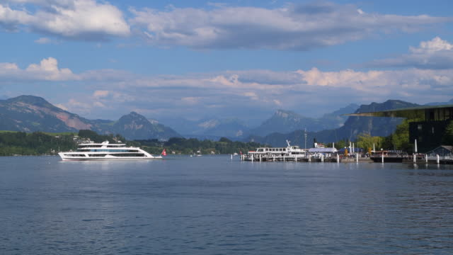 tourboat, and other boats on lake lucerne with lucerne culture and congress centre (on right side). lucerne, lake lucerne, canton of lucerne, switzerland. - lake lucerne stock videos & royalty-free footage