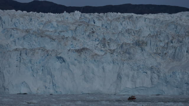 tourboat between ice floes in front the blue wall of ice - greenland stock videos & royalty-free footage