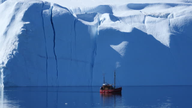 tourboat in front of a magnificient wall of ice - glacier stock videos & royalty-free footage
