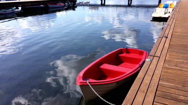 tourboat on lake near pier. - tourboat stock videos & royalty-free footage
