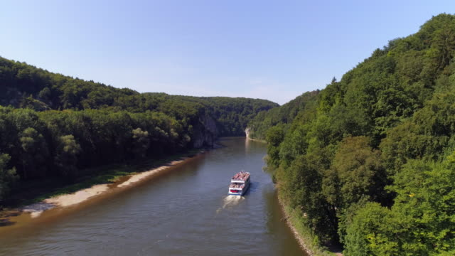 tourboat passing through the danube gorge at kelheim-weltenburg - river danube video stock e b–roll