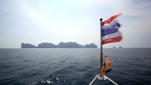 tourboat towards phi phi islands - tourboat stock videos and b-roll footage