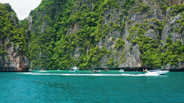 tourboat trip to phi phi islands nearby maya bay, thailand - phi phi le stock videos & royalty-free footage