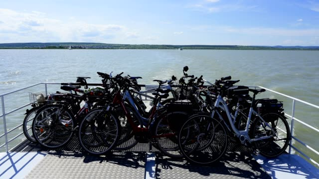 tourboat with cycles on lake neusiedlersee in summer, ilmitz, mörbisch am see, burgenland, austria - tourboat stock videos & royalty-free footage