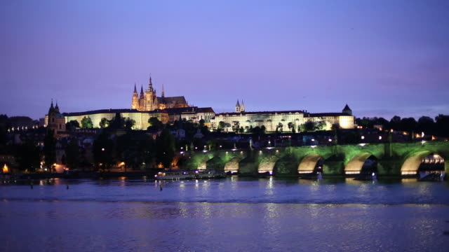 WS Tourboats on Vltava River and Hradcany Castle at dusk/ Prague, Czech Republic