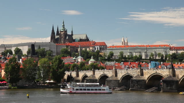 ws tourboats on vltava river and hradcany castle / prague, czech republic - river vltava stock videos & royalty-free footage