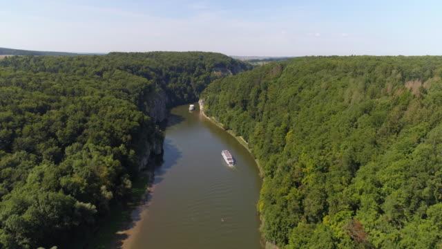 tourboats passing through the danube gorge at kelheim-weltenburg - natural landmark stock videos and b-roll footage
