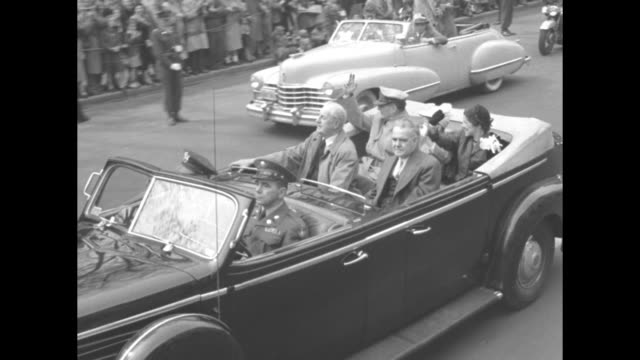 touring car with general douglas macarthur wife jean and son arthur in back dignitaries in center officer driving she smiles and waves handkerchief... - family convertible stock videos & royalty-free footage