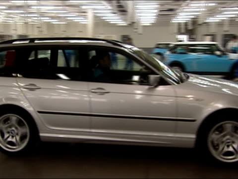 BMW touring leaving garage inside BMW factory / Tokyo, Japan