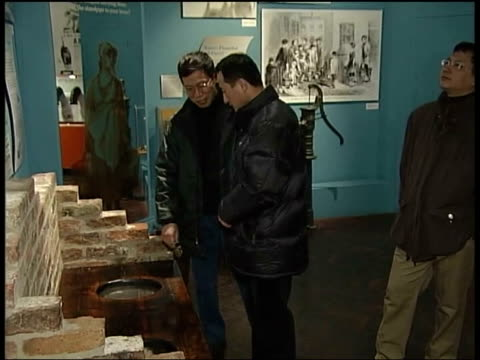 tourism agreement with britain cms emily wang with chinese tourists castle museum digital camera showing snapshots taken ms chinese tourists looking... - digital camera stock videos and b-roll footage