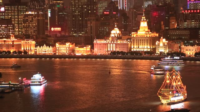 Tourism boat sailing on the Shanghai Huangpu river in the night