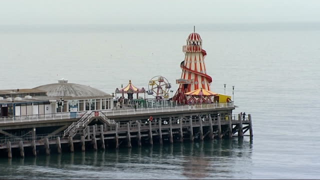 stockvideo's en b-roll-footage met bournemouth seafront general views england dorset bournemouth ext ** music playing in background sot ** general views fairground carousel /... - jogster