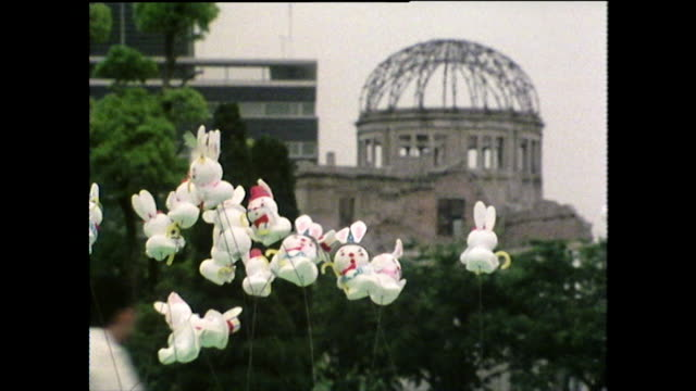tourism in hiroshima peace park with animal balloons; 1975 - nuclear bomb stock videos & royalty-free footage