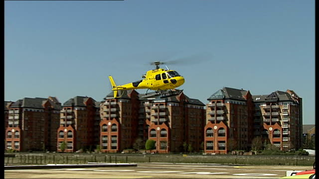 'london helicopter' sightseeing rides noise and safety concerns vox pops battersea heliport the london helicopter landing at battersea heliport... - helicopter landing pads stock videos and b-roll footage