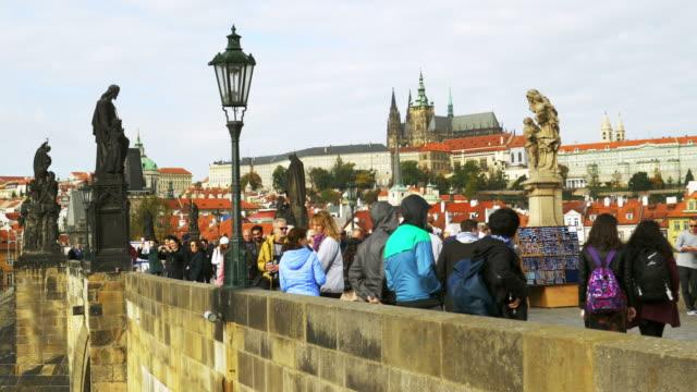 tourism on prague charles bridge - charles bridge stock videos & royalty-free footage