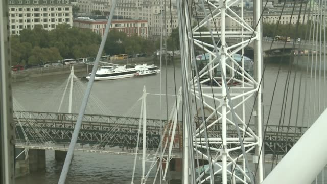 tourism on the river thames int river thames and bridge seen from london eye pod chris gottlieb interview sot [inside london eye pod or capsule] - {{relatedsearchurl('capsule pipeline')}} stock videos and b-roll footage