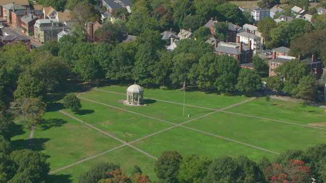 ws aerial pov tourism sitting salem common bandshell steps with townscape / salem, massachusetts, united states - salem stock videos & royalty-free footage