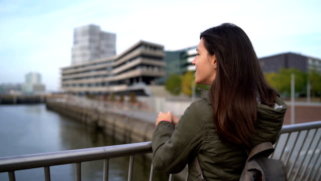 tourist admiring the view in hafen city - memorial stock videos & royalty-free footage