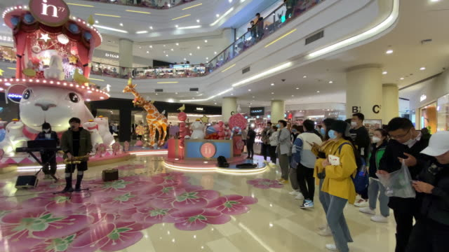 tourist are shopping in shopping mall. for the covid-19 epidemic situation is much better in china, more and more people go outdoors to enjoy early... - バイオハザードマーク点の映像素材/bロール