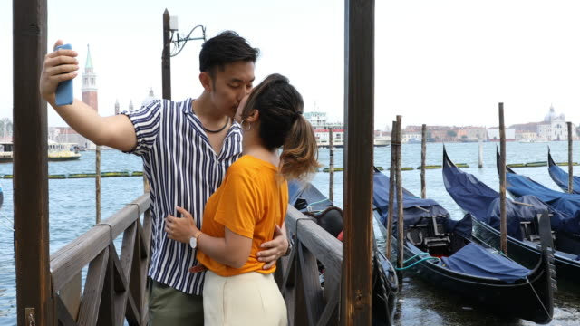 tourist asian couple enjoying holidays in venice, italy - boyfriend stock videos & royalty-free footage