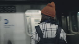 Tourist asian woman waiting train on subway platform.