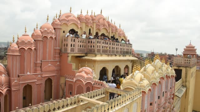 tourist at courtyard of the hawa mahal or the palace of the winds, jaipur, india. - monument stock videos & royalty-free footage