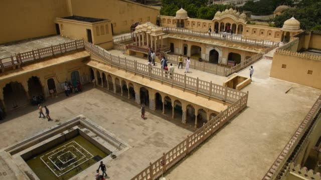 tourist at courtyard of the hawa mahal or the palace of the winds, jaipur, india. - sandstone stock videos & royalty-free footage