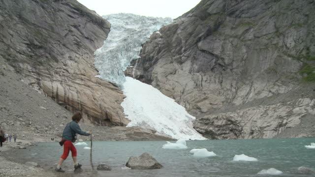 WS Tourist at glacier Briksdalsbreen / Jostedalsbreen Nationalpark, Sogn og Fjordane, Norway