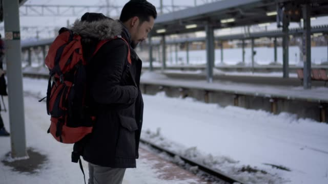 tourist backpacker to travel at train station - waiting stock videos & royalty-free footage