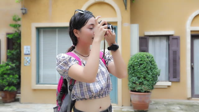 tourist backpackers taking pictures and looking happy ,Relax time on holiday concept travel
