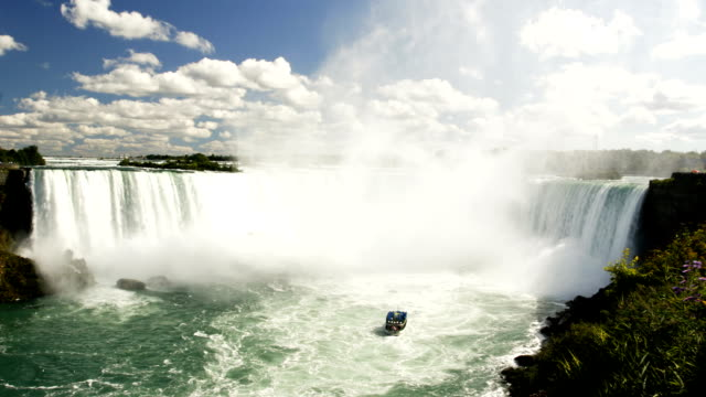 tourist boat approches the horseshoe falls - river niagara stock videos and b-roll footage