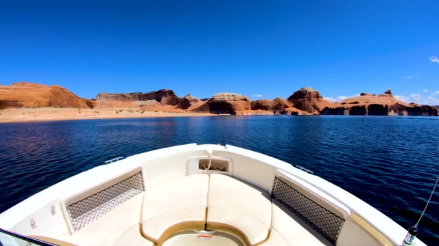 pov tourist boat cruising lake powell utah usa - lake powell stock-videos und b-roll-filmmaterial