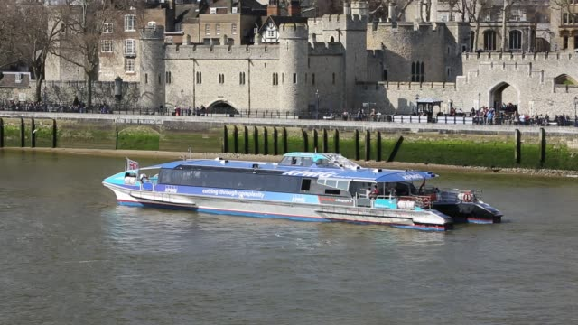 tourist boat infront of the tower of london, on the river thames, london, uk. - in front of stock videos & royalty-free footage