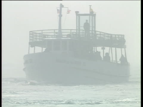 tourist boat 'maid of the mist' sails through mist created by niagara falls royal tour of canada; oct 91 - ausflugsboot stock-videos und b-roll-filmmaterial