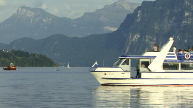 zo, ws, tourist boat on lake lucerne with mountains in background lucerne, switzerland - lake lucerne stock videos & royalty-free footage