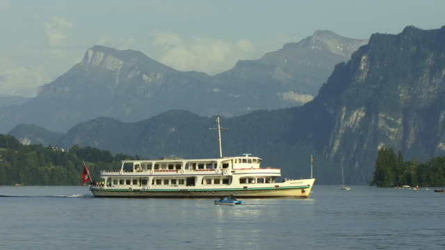 ws, ts, tourist boat on lake lucerne with mountains in background lucerne, switzerland - lake lucerne stock videos & royalty-free footage