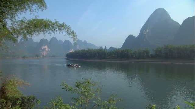 ws, tourist boat on li river, guangxi province, china - li river stock videos & royalty-free footage