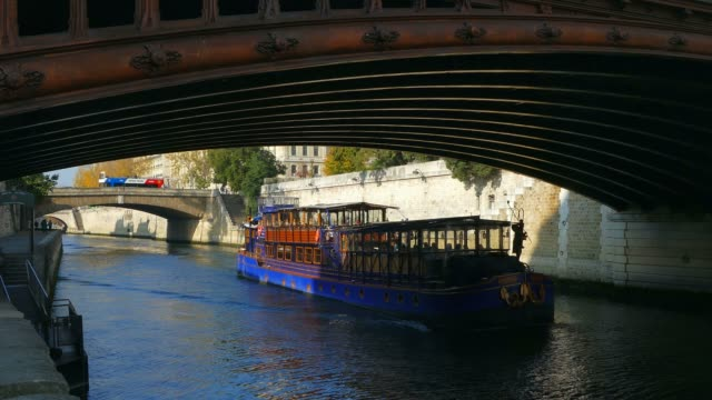 tourist boat on river seine, paris, france - river seine stock videos & royalty-free footage