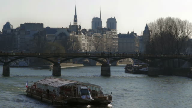 tourist boat riding on the seine river, paris - river seine stock videos & royalty-free footage