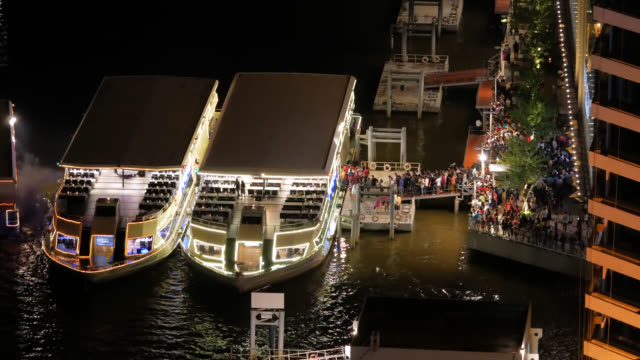 tourist boat waiting for tourist passenger in chaophraya river at night - barge stock videos & royalty-free footage